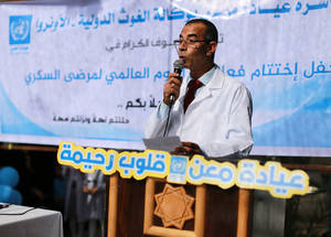 Akram Al-Sha'er, a Lab Technician at the UNRWA Maen Health Centre, recited a poem on the importance of community awareness of diabetes and the importance of following healthy eating habits and working out. The poem is written in a simple informal language, with a message easily understood by everyone. © 2016 UNRWA Photo by Rushdi Al Sarraj