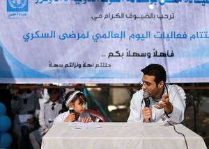 Student Menna Kaware', a member of Maen Elementary school parliament, conducted a dialogue sketch between her and a doctor. The sketch included questions and answers on diabetes aimed at providing advice to people on how to avoid being susceptible to the illness. © 2016 UNRWA Photo by Rushdi Al Sarraj