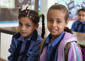 """I am very happy to have a new bag; this is much better than mine!"" says third-grader Shahed. ""Last year, my parents had to buy me a new bag but this is much better!"" © 2016 UNRWA Photo by Ahmad Abu Haweleh"