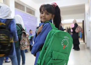 """I think I will come to school happier now that I have my new bag,"" says first-grader Amneh. © 2016 UNRWA Photo by Ahmad Abu Haweleh"