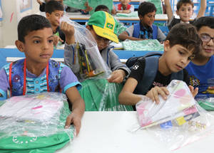 The students were among the 2,500 Palestine refugee children in Jerash camp who received school bags and stationery kits thanks to a generous donation by the Chalhoub Group. © 2016 UNRWA Photo by Viola Bruttomesso