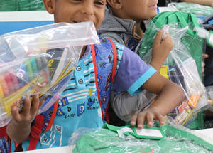 Students at the Jerash Boys Preparatory School open their new school bags donated by the Chalhoub Group. © 2016 UNRWA Photo by Viola Bruttomesso