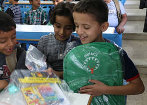Students at the Jerash Boys Preparatory School examine the contents of the stationery kits they received from the Chalhoub Group. © 2016 UNRWA Photo by Viola Bruttomesso