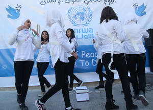 As part of the activities facilitated by UNRWA schools for Human Rights Day, students at the Hussein Eid School in Damascus showcase their talents in dance, drama and the arts. © 2016 UNRWA Photo by Taghrid Mohammad