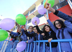 Students at the Russifeh Preparatory Girls School No. 2 and 3 in Zarqa, Jordan, participate in festivities commemorating Human Rights Day, held every year on 10 December. © 2016 UNRWA Photo by Mohammad Maghayda