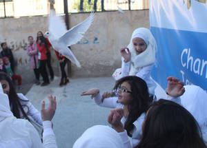 "When asked about the Human Rights Day activities in UNRWA schools, Ilham al-Refai, an UNRWA parent from the Hussein Eid School in Damascus, noted, ""It is a great day because it gives our children the chance to be more confident, thoughtful, tolerant and active in their local community and the global community."" © 2016 UNRWA Photo by Taghrid Mohammad"