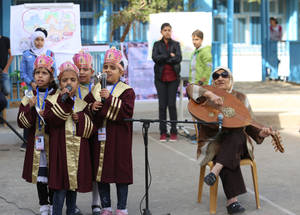 Students from the UNRWA Rehabilitation Centre for Visually Impaired (RCVI) perform a song during the Human Rights Day ceremony held at Al-Zaytoun Preparatory Girls' School A in Gaza City. © 2016 UNRWA Photo by Tamer Hamam