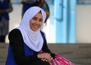 """Although I am a Palestine refugee living in Gaza and witnessing all this injustice, I still believe in the values within human rights and I am sure that one day, we will enjoy these precious rights,"" says 14-year-old Nesma al-Louh, a ninth-grade student at Al-Zayoun Prepatory Girls' School A in Gaza City. © 2016 UNRWA Photo by Tamer Hamam"