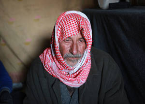 "For elderly people, winter seems even harder. Sixty-two-year-old Mithqal, who has five sons and four daughters, arrived at Khan Dunoun shelter in 2012. ""The water freezes in the morning and we can't wash our hands. We suffer from the cold and the lack of heat"". Khan Dunoun, Syria. © 2016 UNRWA Photo by Taghrid Mohammad"