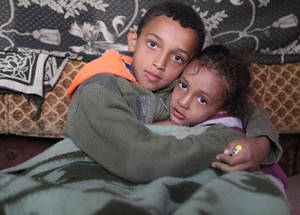 "Despite the hardship and sadness, Ameenah's son Ali explains that he confronts the freezing temperatures by thinking of the wellbeing of his family members. Although the 13-year-old boy feels cold, he does not mind taking off his only jacket to give to his little sister.  ""And I often sing to try to forget our miserable situation"", he says. Khan Dunoun, Syria. © 2016 UNRWA Photo by Taghrid Mohammad"