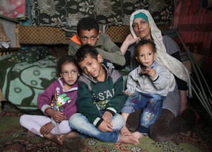 Widow and mother of five Ameenah Joumaa Mohammad is the sole provider for her family. Being the eldest, her 13-year-old son Ali Hussein Sakr feels a sense of responsibility to help his mother care for his siblings. Khan Dunoun, Syria. © 2016 UNRWA Photo by Taghrid Mohammad