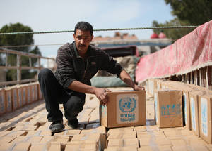 Food distribution is a critical component of the Agency's emergency response in Syria, as food insecurity continues to negatively affect Palestine refugees. Food parcels are designed to meet approximately one third of daily caloric needs (almost 700 kcal per person per day). Damascus, Syria. © 2016 UNRWA Photo by Taghrid Mohammad