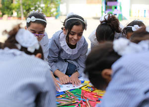 Students from Al-Amal Preparatory School for Girls in Khan Younis, southern Gaza, participate in psychosocial support activities. Through the 2017 Emergency Appeal, UNRWA will provide various forms of psychosocial support to both children and adults to help build resilience, mitigate the impact of conflict-related trauma and protect vulnerable refugees. © 2016 UNRWA Photo by Rushdi al-Sarraj