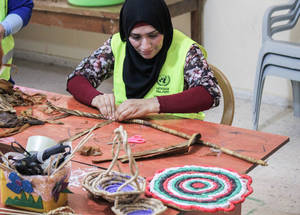 A Palestine refugee participant from Ein el-Sultan camp engages in handicraft work as part of the West Bank emergency Cash-for-Work (CfW) programme, which provides short-term work opportunities to food-insecure refugees in the West Bank. Through the 2017 Emergency Appeal, UNRWA will support 8,000 refugee households across 19 West Bank camps to help meet their basic needs through CfW. © 2016 UNRWA Photo by Tala Zeitawi