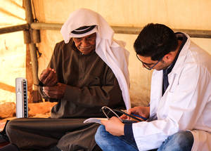 A medical officer attends to a Palestine refugee Bedouin from Ein Samia in the West Bank during a visit by the UNRWA mobile health clinic. Through this year's Appeal, UNRWA mobile health clinics will provide access to preventative and curative health-care services in 58 localities across the West Bank, specifically targeting vulnerable communities in Area C, the Seam Zone and East Jerusalem. © 2016 UNRWA Photo by Tala Zeitawi