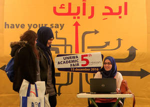 """Assisting at the Academic Fair is very rewarding to me,"" said Fatima al-Hajj Moussa, a beneficiary of the EU-funded scholarship programme facilitated by UNRWA in Lebanon and an Economics from the American University of Beirut (AUB). ""Being a previous beneficiary of the EU-funded scholarship programme at UNRWA, I feel proud to be chosen and given the chance to share the benefits of the timely opportunity granted to me."" Hoops Club, Beirut. © 2016 UNRWA Photo by Ali Hashisho"