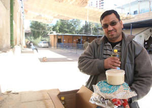 "Imad Abdel-Rahim Labada is a 39-year-old father of four from Kaboun in Damascus. Imad is thankful for the UNRWA food parcel as it ""contains some of the most essential ingredients for cooking.""KSRelief's generous donation of US$ 1 million was instrumental in ensuring the first round of food assistance in 2017 to one of the most vulnerable populations in Syria. Imad Abdel-Rahim Labada, Alliance distribution centre, Damascus, Syria. © 2017 UNRWA Photo by Taghrid Mohammad"