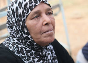 """UNRWA cash assistance provides me with the means to purchase basic goods on the local market and pay the rent for our apartment,"" says 65-year-old Rasmiyeh Hussein, who had to flee Yarmouk due to intense clashes in December 2012.  Damascus, Syria. © 2016 UNRWA Photo by Taghrid Mohammad"