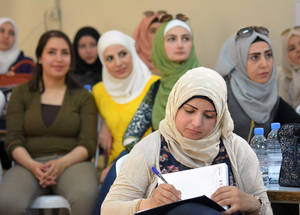 In a bid to support the firm commitment of families to education, UNRWA has set up 82 Parent-Teacher Associations throughout Damascus and central Syria. Over 500 parents have worked with UNRWA trainers to learn the skills they need to help their children cope with war conditions. Education training, Damascus Training Centre, Syria. © 2017 UNRWA Photo by Taghrid Mohammad