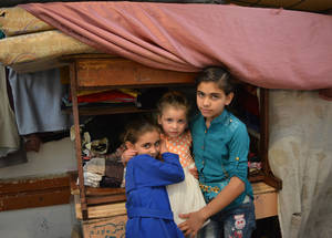 For these three little girls who are internally displaced, family is the foundational element of their emotional well-being and the source of self-respect and the respect of others. The three sisters live in a single room with their mother, father and brother in an UNRWA collective shelter. Haifa School collective shelter, Damascus, Syria. © 2017 UNRWA Photo by Taghrid Mohammad