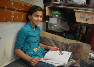 """Family has a very important role in education. My family's priority is to support our studies and help us develop good study habits. For me, the family means love and harmony,"" says 12-year-old Qamar. Haifa School collective shelter, Damascus, Syria. © 2017 UNRWA Photo by Taghrid Mohammad"