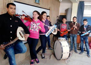 In Latakia, Syria, Qamar and her classmates from the UNRWA El Khairieh School worked on ways to improve their school environment with the school's administration. They planted new trees and plants in their schoolyard, decorated classroom walls and hallways, and set up a school orchestra. © 2017 UNRWA Photo by Taghrid Mohammad.