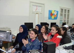 """My Voice-My School helped me become an advocate as I told people overseas about how I want to solve some of the education issues I face,"" says Assile (middle in second row) at the UNRWA Jalloud Preparatory School for Girls in Burj Barajneh camp in Lebanon. With her classmates, she has been advocating for more psychological support and physical improvements to their school. They would like a bigger playground with trees and a theatre to perform plays. © 2016 UNRWA Photo by Akram Ismail Afara."