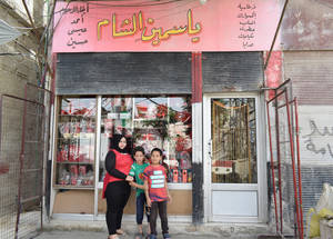 After several displacements, 30-year-old Hanan Odah finally found refuge in Jaramana camp. In 2016, she benefited from one of the 9,520 microfinance loans granted by UNRWA that year. The loan allowed her to start her own stationery and perfume business, enabling her to support her family of three. Jaramana camp, Damascus, Syria © 2017 UNRWA Photo by Wasim Al-Masri
