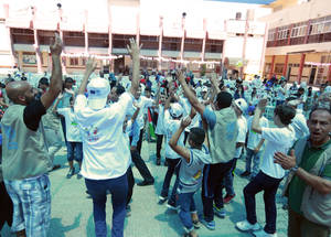 The students from Gaza and the West Bank share moments of joy and fun during the closing ceremony of the SFW activities at the UNRWA Rehabilitation Centre for Visually Impaired (RCVI). 16 July 2017. © 2017 UNRWA Photo by Fadi Thabet