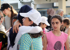 Students from Gaza and the West Bank say their farewells to each other at the end of the Camping Activity during the Summer Fun Weeks in Gaza. 20 July 2017. © 2017 UNRWA Photo by Fadi Thabet