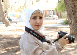 """Youth should look at themselves and see how they can serve their community,"" says Waed, a 20-year-old graphic design graduate. ""For me, through my photos, I believe that I can transmit the idea of peace to people."" Damascus Training Centre, Syria. © 2017 UNRWA Photo by Taghrid Mohammad"