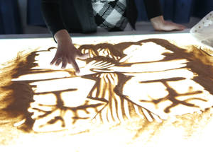 Nermin, who studied graphic design at the UNRWA Damascus Training Centre, has a passion for sand art. Her graduation film project featured sand art drawings of the war and the emigration from Syria by sea. Damascus Training Centre, Syria. © 2017 UNRWA Photo by Taghrid Mohammad
