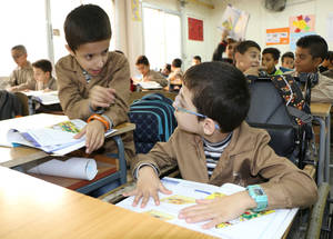 UNRWA is working to support the inclusion of all children with disabilities in its schools by focusing on the accessibility of the school environment. At the Majjedo School inclusive accessibility has enabled students who use wheelchairs to learn alongside their peers. © 2017 UNRWA photo by Maysoun Mustafa