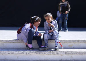 During their recess, two students gather to chat at the UNRWA Rehabilitation Centre for the Visually Impaired. Photo credit: © 2017 UNRWA photo by Rushdi Al Sarraj