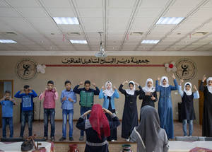A group of children with hearing disability rehearse a song they will perform during the UNRWA celebration of International Day of Persons with Disabilities at Deir el Balah Community Rehabilitation Centre, a partner of the Agency's Relief and Social Services Programme.  © 2017 UNRWA photo by Tamer Hamam