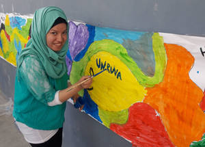 A student paints a vibrant mural during an UNRWA Family Recreation Day for children with disabilities in Shu'fat refugee camp in the West Bank. This day was made possible through the UNRWA Healthy Camp Initiative. © 2017 UNRWA photo by Mohammad Araj