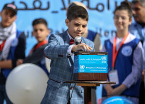 "As Karim placed his savings into a donation box, he appealed to the world to #FundUNRWA.  ""Every contribution counts so I am making the first step,"" he said. © 2018 UNRWA Photo Rushdi Al Saraj"