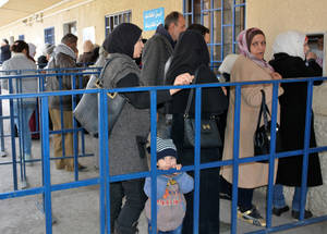 It's a cold February morning in Damascus, but people are already lining up at the Damascus Training Center (DTC) in the UNRWA compound. They are picking up their cash assistance, which will allow them to keep a roof over their head, put food on their table and pay for fuel to heat their homes.In 2018, UNRWA aims to provide cash grants of US$32 per month to 418,000 Palestine refugees in Syria in six rounds of distribution. © UNRWA 2018 Photo by Iyad Faouri