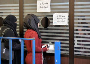 Distributing the funds is a logistical processinvolving UNRWA installations, as well as local banks. Every two months, eligible Palestine refugees in Syria receive a text message allocating a time to pick up their assistance. © 2018 UNRWA Photo by Iyad Faouri