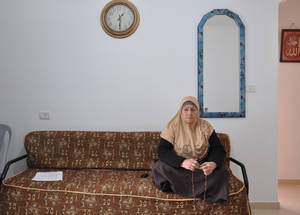 Fahmia Shamesneh, sits in the rental apartment in which she now lives. With EU humanitarian aid UNRWA provided cash assistance to the family to help them secure housing for the first six months following their displacement from Sheikh Jarrah, and helping them to re-establish their lives.  ©2018 UNRWA Photo by Lára Jónasdóttir