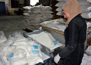 Food boxes being packed for the convoy to aid Palestine refugees who fled from Yarmouk to Yalda. Palestine refugees were provided with ready to eat food baskets. Between 4-10 June, UNRWA distributed food baskets to more than 750 families. © UNRWA 2018 Photo by Iyad Faouri