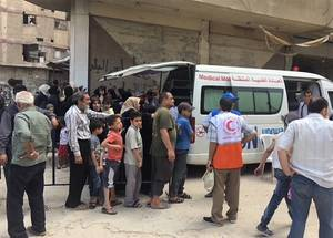 Patients line up for appointments with an UNRWA mobile health clinic in Yalda. © UNRWA 2018 Photo by Laura Sunnen