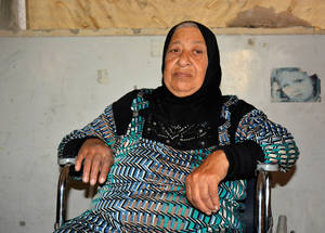 "UNRWA provided Ratiba al-Jaafari, 80 years-old with a wheelchair. She is from Yarmouk, and can think of only one thing: going home. ""The situation is overwhelming. Our lives are threatened, we need to find a place to live since our homes have been destroyed.  We do not have money to rebuild our homes in the camp. Yarmouk camp is my soul. We built our home with our bare hands."" © UNRWA 2018 Photo by Iyad Faouri"
