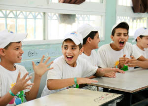 To escape the summer heat, students at the UNRWA Hebron Boys' School participate in a series of outdoor and indoor activities facilitated by 50 UNRWA faculty throughout the summer. © 2018 UNRWA Photo by Iyas Abu Rahma