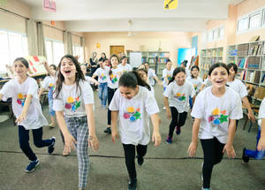 Crowded camp conditions and a lack of open recreational spaces present many Palestine refugee children with few alternatives in the summer when school is not in session. EU Fun Days for the students of Aida Girls' School meant dancing and laughing with peers. © 2018 UNRWA Photo by Iyas Abu Rahma