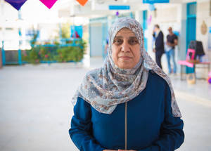 "Sabah Arar is a science teacher at the UNRWA Jalazone Basic Girls' School. ""All our teachers have realized how the financial deficit affects our students and the school. There was fewer teachers employed, there are less school supplies and lab equipment available for the students to use,"" she added, ""We believe in education, it is all we've got, it's our future."" © 2018 UNRWA Photo by Ameen Saeb"