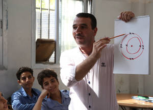 """One of my best students, who I taught in Yarmouk camp at the start of my career as a teacher, has now completed his academic studies and works at a bank. It's so rewarding, and inspiring, to see one of your students doing well in life,"" says Abdallah Nassif, a science teacher at Palestine School in Damascus. © 2018 UNRWA Photo by Taghrid Mohammed"
