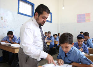 """My greatest achievement as a teacher has been to see the difference I can make in the life of my students,"" says Bassam Agha, an Islamic studies teacher. ""My students have been emotionally scarred by displacement and the subsequent disruption of their education. We are trying our best to help them cope with this difficult situation."" © 2018 UNRWA Photo by Taghrid Mohammed"