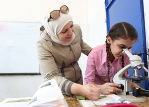 """It's important to stay up to date on the latest teaching techniques, that way we can engage the students more,"" says Hanan al-Toubeh who teaches science at the UNRWA Palestine School. ""Over the last few years, we have worked to increase coping skills and resilience at the school, in order to help children cope with the extreme stress they face,"" she notes. © 2018 UNRWA Photo by Taghrid Mohammed"