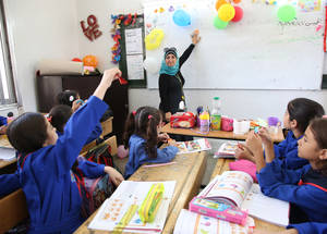 """I work hard to make the classroom fun and convey lessons in a playful way,"" says Rudi al-Bash, a fourth grade teacher at the Palestine school. ""Teaching brings positive energy into my life. That energy ripples outward into other aspects of your life."" © 2018 UNRWA Photo by Taghrid Mohammed"